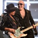 Musician Joe Perry and rapper Pitbull perform onstage during The 58th GRAMMY Awards at Staples Center on February 15, 2016 in Los Angeles, California.