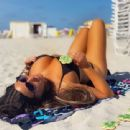 Claudia Romani – Posing on the beach for St Patrick's Day in Miami - 454 x 340