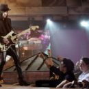Mick Mars performs onstage at the 2004 Spike TV Video Game Awards at Barker Hanger on December 14, 2004 in Santa Monica, California - 454 x 312