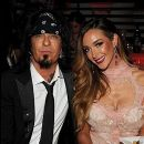 LOS ANGELES, CA - MAY 01: Musician Nikki Sixx (L) and model Courtney Bingham in the audience at the 2014 iHeartRadio Music Awards held at The Shrine Auditorium on May 1, 2014 in Los Angeles, California. iHeartRadio Music Awards are being broadcast live on