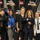Metallica pose in the press room during the 24th Annual Rock and Roll Hall of Fame Induction Ceremony at Public Hall on April 4, 2009 in Cleveland, Ohio - 454 x 326