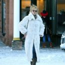 Melanie Griffith runs into Goldie Hawn and a friend while out shopping in snowy Aspen, Colorado on December 27, 2014