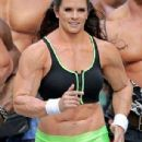Danica Patrick displays bulky frame to film Super Bowl commercial..... but it's just a muscle suit - 306 x 713