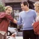 Pistachio (Dana Carvey) meets his beautiful assistant's boyfriend, Trent (Mark Devlin) as Jennifer (Jennifer Esposito) looks on in Columbia's The Master of Disguise - 2002