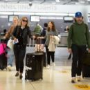 Elle Fanning and Olivia Wilde – Arrive at JFK Airport in NYC
