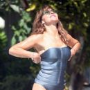 Lizzie Cundy in Silver Swimsuit on the pool in Barbados - 454 x 681