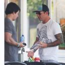 Aquahydrate owner and actor Mark Wahlberg chats about the water business with 138 Water's Adam Drexler in Beverly Hills, California on August 28, 2014