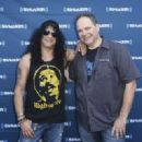 Slash and Eddie Trunk attend SiriusXM Volume Presents Eddie Trunk Live at The Rainbow on August 3, 2018 in Los Angeles, California