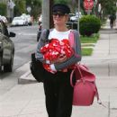 Paris Hilton with her dog out in West Hollywood - 454 x 681