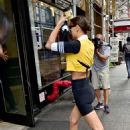 Irina Shayk in Bicycle Tights and Yellow Sport Top – Out in New York City