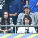 Sir Mick Jagger and his lookalike son Lucas join the rocker's other children Lizzie and James as they watch Portugal claim victory in EURO 2016 Final - 454 x 260