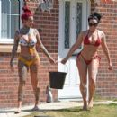 Jemma Lucy and Laura Alicia Summers in Bikini – Car Washing in Manchester - 454 x 397