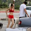 Miley Cyrus in Red Shorts and Sports Bra hiking in LA - 454 x 302