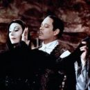 Anjelica Huston and Raul Julia in  Addams Family Value (1993)