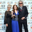 Anita Dobson, Katie Brayben, winner of Best Actress In A Musical for 'Beautiful: The Carole King Musical' and Brian May in the winners room at The Olivier Awards at The Royal Opera House on April 12, 2015 in London, England. - 420 x 600