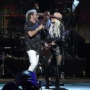Orianthi and Sammy Hagar perform onstage during MusiCares Person of the Year honoring Aerosmith at West Hall at Los Angeles Convention Center on January 24, 2020 in Los Angeles, California - 454 x 356