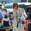 Jenna Coleman is the epitome of festival chic as she attends Glastonbury in floral kimono