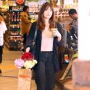 Dakota Johnson – Leaving Erewhon grocery store in Los Angeles - 454 x 681