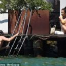 PICTURE EXCLUSIVE: Irina Shayk struggles to contain her perky assets in a skimpy yellow bikini as she cosies up to handsome beau Bradley Cooper on romantic getaway to Lake Garda - 454 x 307