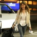 Behati Prinsloo departing a flight out of Los Angeles Int'l Airport January 30,2015