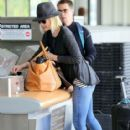 Leslie Bibb and Sam Rockwell departing on a flight at LAX airport in Los Angeles, California on January 26, 2015. The pair were all smiles as they made their way through the airport