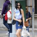 Famke Janssen – Leggy wearing a blue denim mini skirt in Soho - 454 x 678