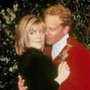 Ian Ziering as Steve Sanders and Kathleen Robertson as Clare Arnold in Beverly Hills, 90210.