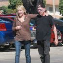 Daryl Hannah looked loved up with Neil Young as they headed to a restaurant in Westlake, California, on Tuesday September 9, 2014 - 454 x 568