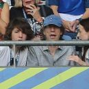 Sir Mick Jagger and his lookalike son Lucas join the rocker's other children Lizzie and James as they watch Portugal claim victory in EURO 2016 Final