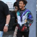 Jaden Smith puts his arms around Kylie Jenner and shows her an item while shopping together at Crystalarium on Tuesday (November 19) in West Hollywood, Calif