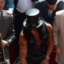 Slash performs at the Hard Rock Cafe after being honored with the 2,473rd Star on the Hollywood Walk of Fame on July 10, 2012 in Hollywood