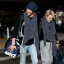 Chad Michael Murry and Nicky Whelan arrive at LAX airport on November 20, 2013 - 416 x 594