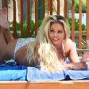 Bianca Gascoigne in Bikini on the pool in Dubai - 454 x 314