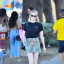 Emma Roberts in Mini Skirt on Melrose Avenue in Los Angeles - 454 x 681