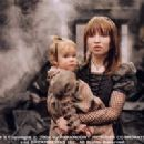 Sunny (Kara Hoffman/Shelby Hoffman) and Violet (Emily Browning) in Paramount Pictures' Lemony Snicket's A Series of Unfortunate Events. - 300 x 200
