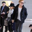 Eva Mendes and Ryan Gosling At Charles DeGaulle Airport, Paris November 27, 2011