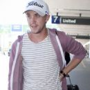Tom Felton arrived at Los Angeles International Airport yesterday, July 18. He was returning from promoting Harry Potter and the Deathly Hallows: Part 2 in Brazil