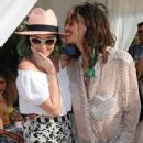 Singers Katy Perry (L) and Steven Tyler attend the debut of Moet & Chandon Ice Imperial at the LACOSTE Beautiful Desert Pool Party on April 12, 2014 in Thermal, California