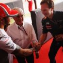 Lewis Hamilton (L) of Great Britain and McLaren shakes hands with Red Bull Racing Team Principal Christian Horner (R) as they attend an event to celebrate the 82nd birthday of F1 supremo Bernie Ecclestone (C) before the Indian Formula One Grand Prix at Bu