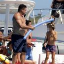 Retired football legend Ronaldo, 42, appears in great spirits as he takes a massive leap into the sea on fun-filled family trip in Spain - 454 x 681