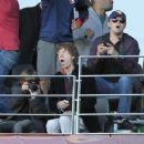 Leonardo DiCaprio sits behind Mick Jagger and his young son Lucas to watch the World Cup quarter final match between Germany and Argentina