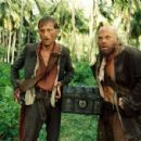 MacKenzie Crook as Ragetti and Lee Arenberg as Pintel in Walt Disney Pictures' Pirates of the Caribbean: Dead Man's Chest - 2006 - 454 x 299