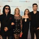 Musician Gene Simmons of Kiss, Shannon Tweed, Sophie Simmons and Nick Simmons attend the Spirit of Excellence Awards 2014 at the Hyatt Regency Century Plaza on September 23, 2014 in Century City, California