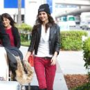 Victoria Justice is all smiles as she arrives at LAX (Los Angeles International Airport