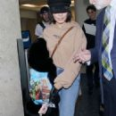 Vanessa Hudgens and Austin Butler at LAX Airport in LA - 454 x 747