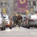Kar (Seann William Scott) and the Monk (Chow Yun Fat) run through the streets to avoid pursuers - 454 x 296