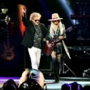 Orianthi and Sammy Hagar perform onstage during MusiCares Person of the Year honoring Aerosmith at West Hall at Los Angeles Convention Center on January 24, 2020 in Los Angeles, California - 454 x 303