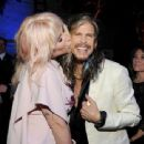 Steven Tyler and singer Kesha attend The Humane Society of the United States' to the Rescue Gala at Paramount Studios on May 7, 2016 in Hollywood, California - 454 x 340