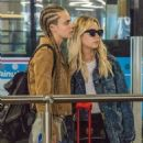 Ashley Benson and Cara Delevingne at Heathrow Airport in London - 454 x 605