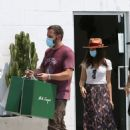 Ana De Armas – Looks cute in summer dress with Ben Affleck at Nick Fouquet hat shop in Venice - 454 x 631